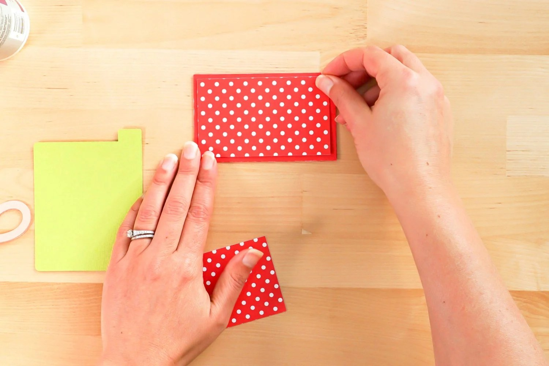Hands adding polka dot pieces