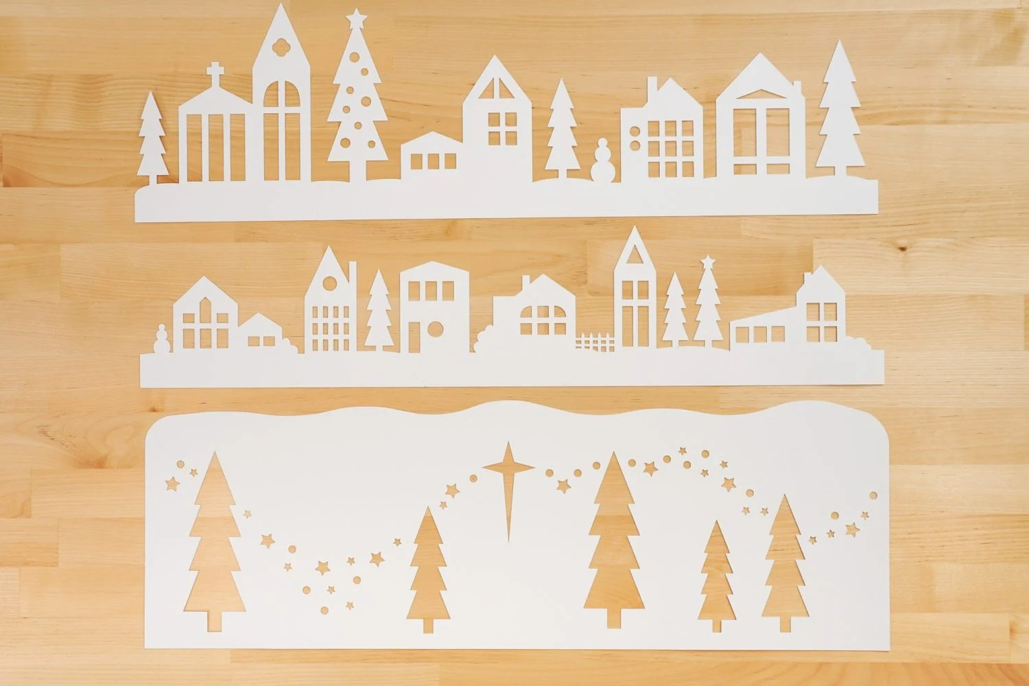 Three layers of the papercut Christmas village