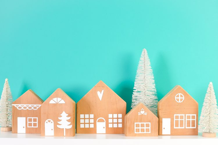 Finished Scandi Style Houses with faux trees on teal background