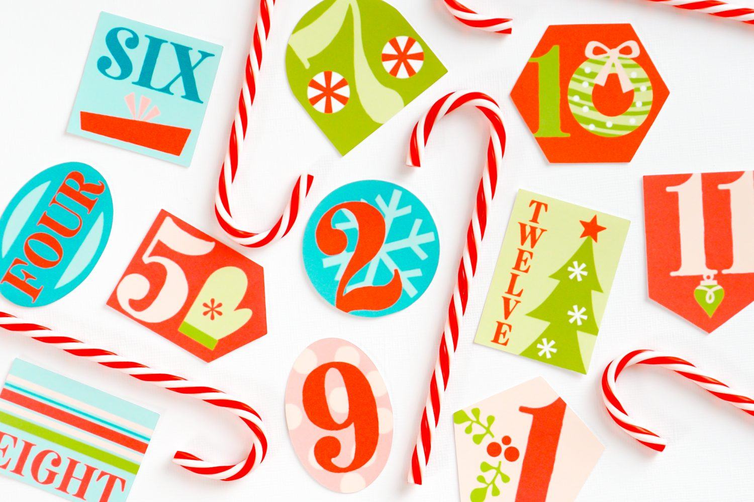 Finished 12 Days of Christmas gift tags staged with faux candy canes
