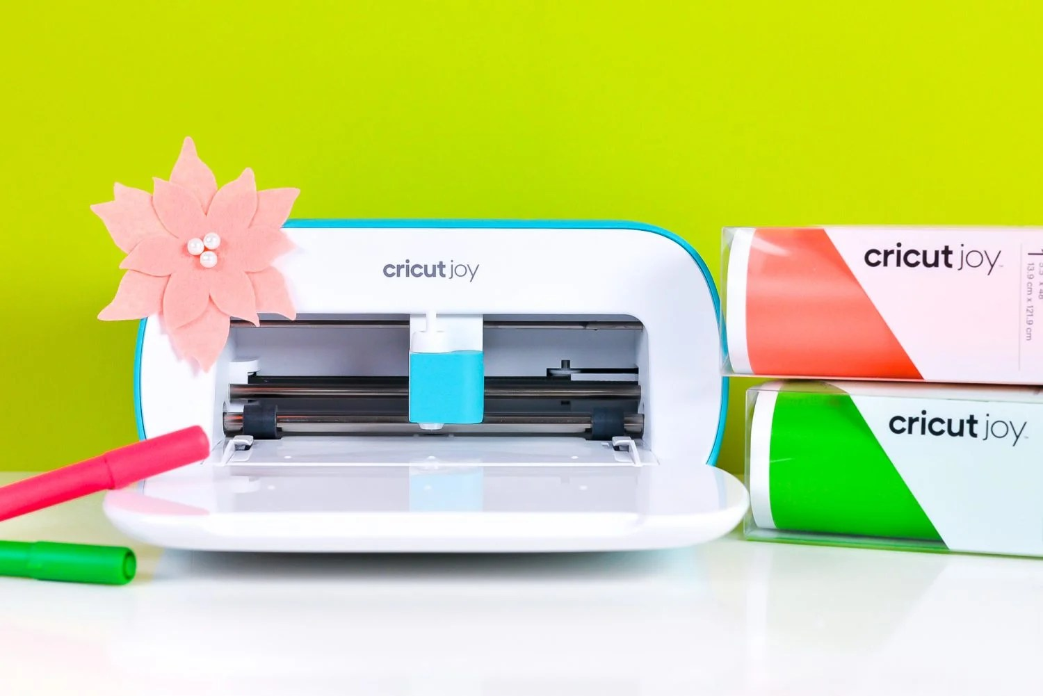 """Cricut Maker """"decorated"""" for Christmas with felt poinsettia and bow plus matching materials"""