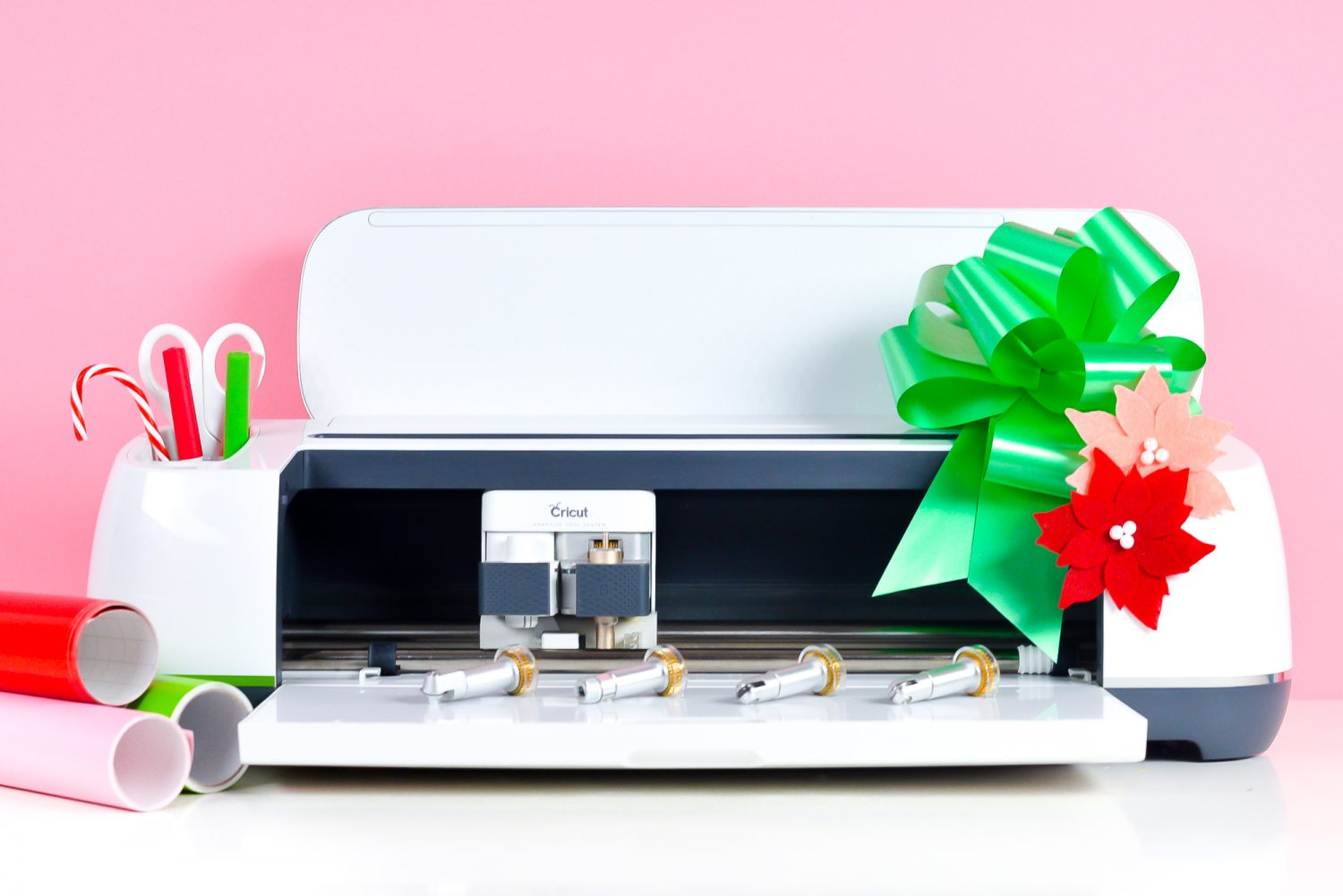 """Cricut Maker """"decorated"""" for Christmas with candy cane and bow plus matching materials"""