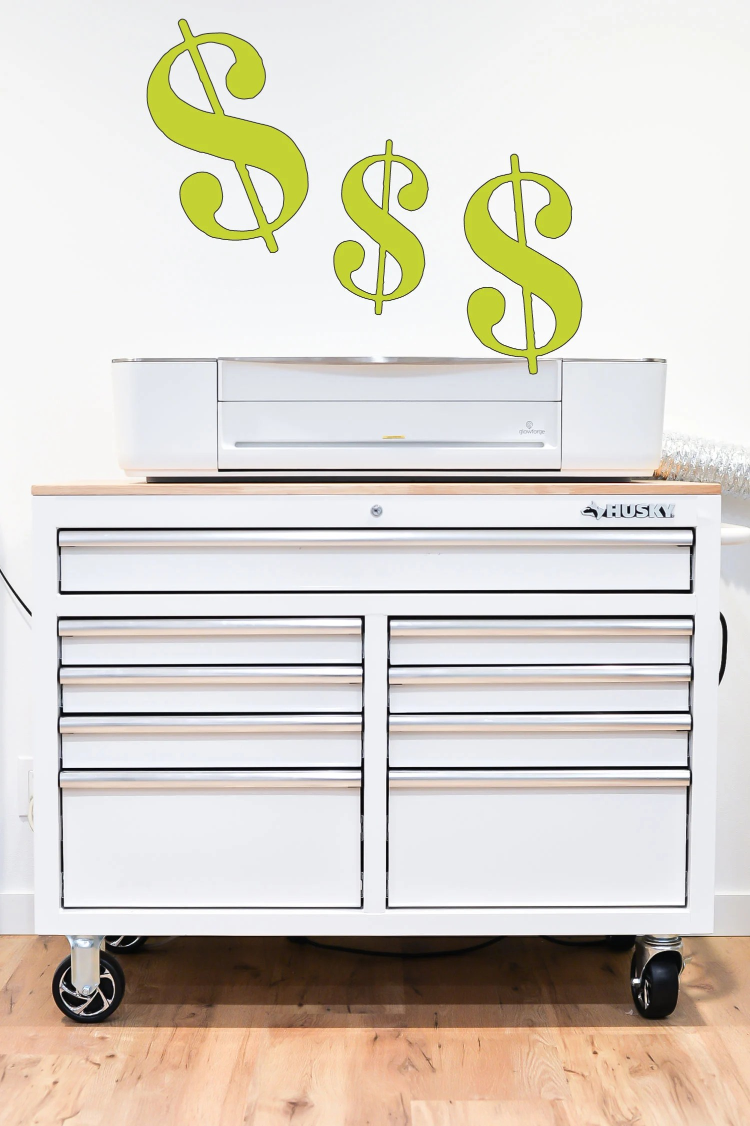 Glowforge with Dollar Signs coming out of it