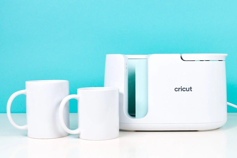 Cricut Mug Press with two sizes of Cricut Mugs