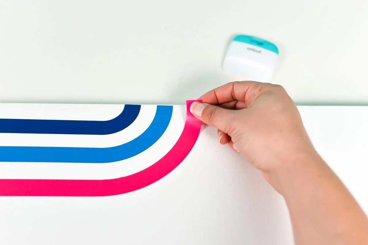 Using hands to apply the rainbow decals