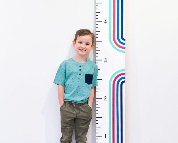 Boy standing with height ruler