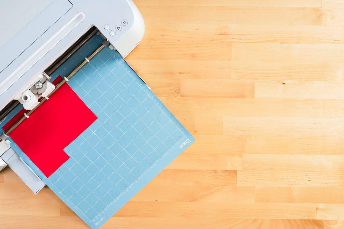 Cricut Maker cutting red vinyl