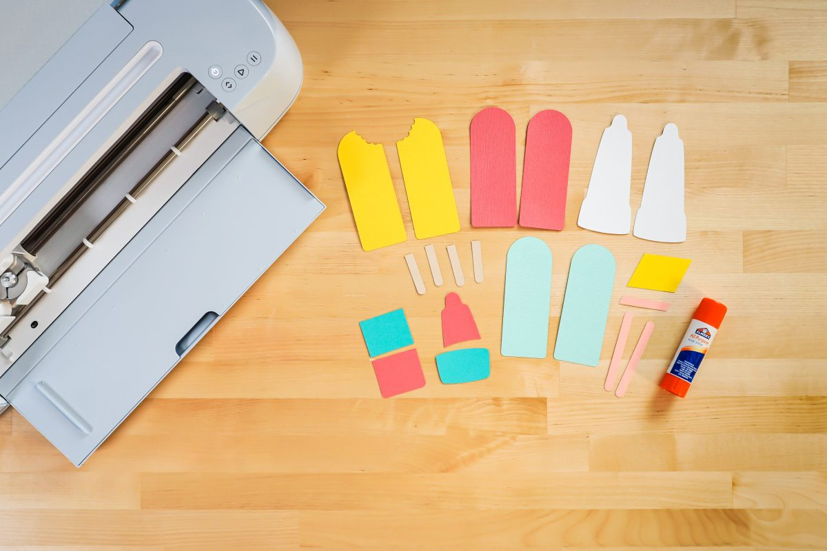 Popsicle Pieces cut from cardstock on table