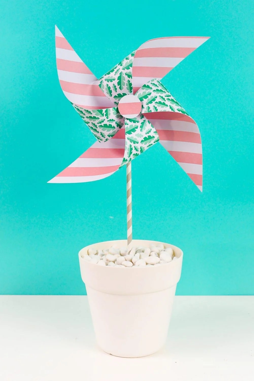 Final paper pinwheel on a teal background