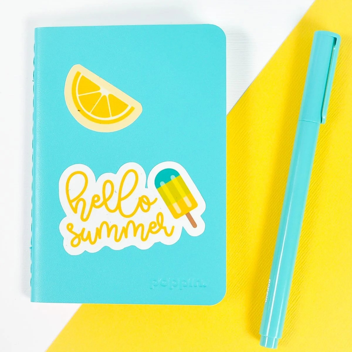 Blue notebook with summer stickers on white and yellow background