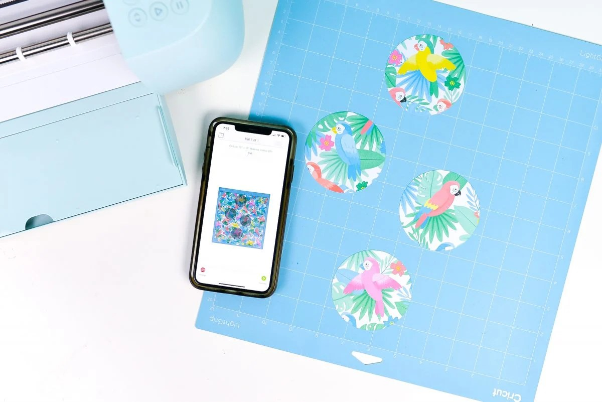 iPhone with Snap Mat screen, plus mat with fussy cut paper and Cricut Explore 3