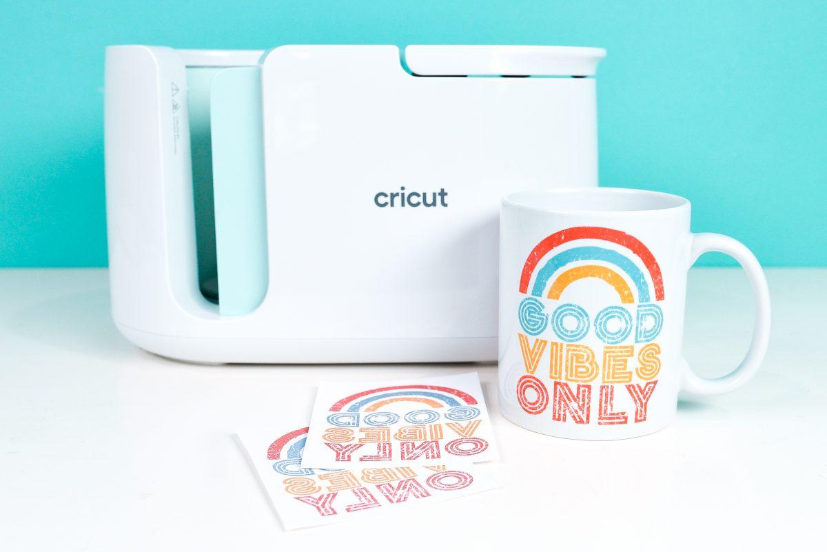 Cricut mug press with Good Vibes Only mug and transfers