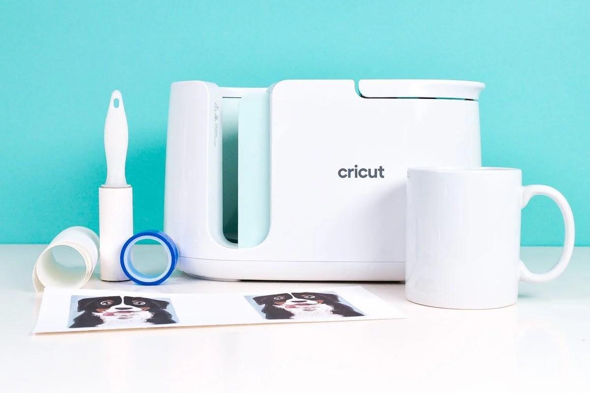 Cricut Mug Press, mug, lint roller, tape, butcher paper, sublimation transfer