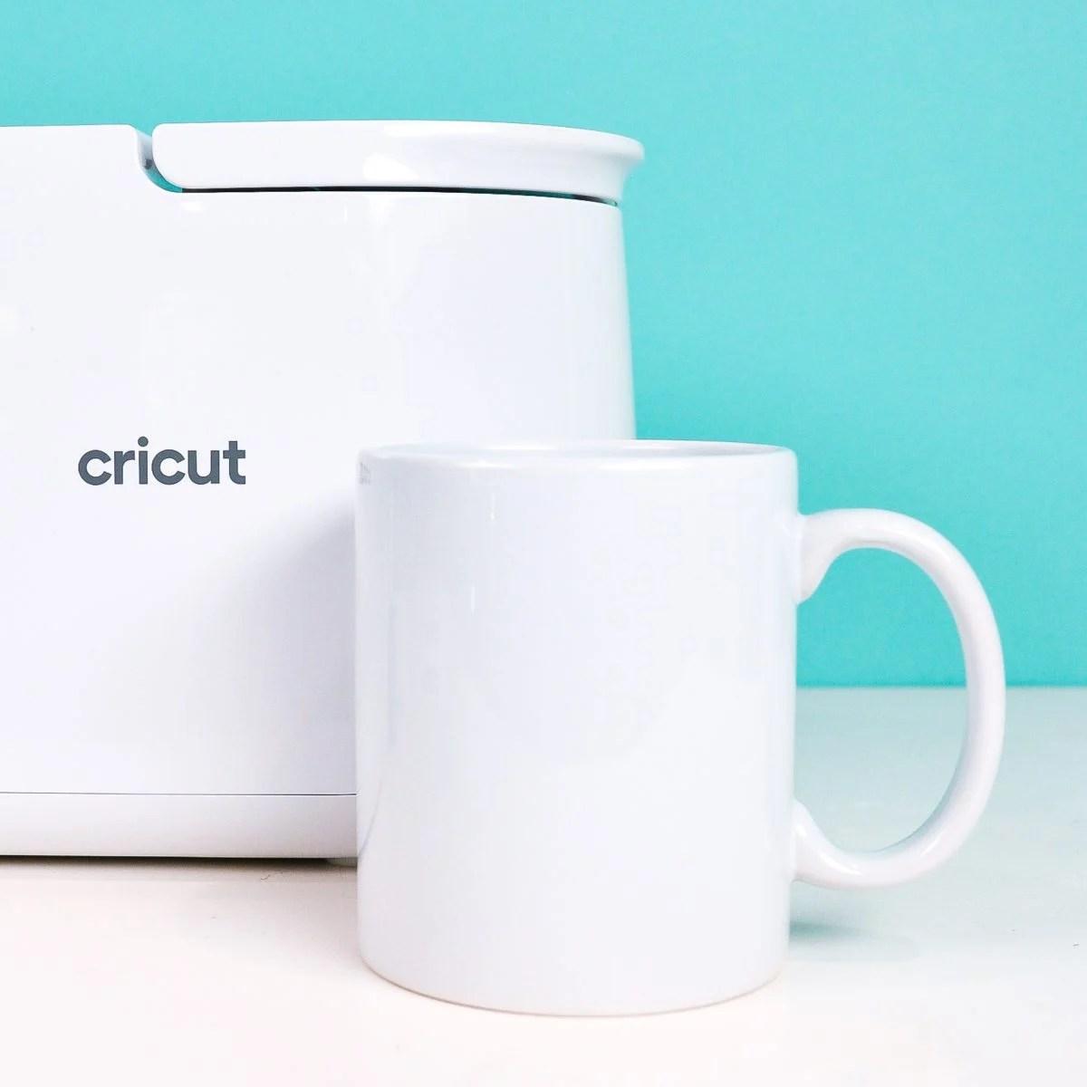 Blank Cricut mug in front of Cricut Mug Press