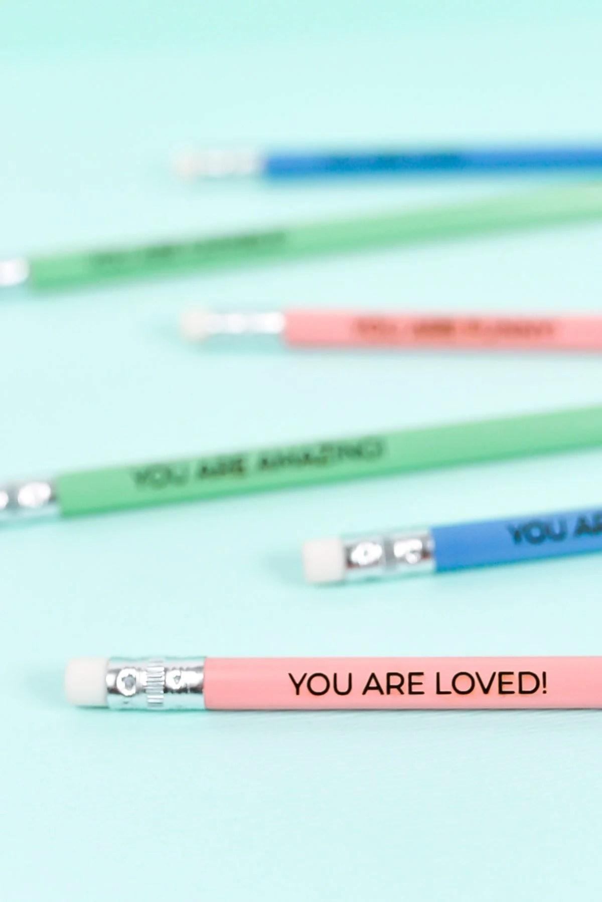 Engraved Pencils on Blue Background