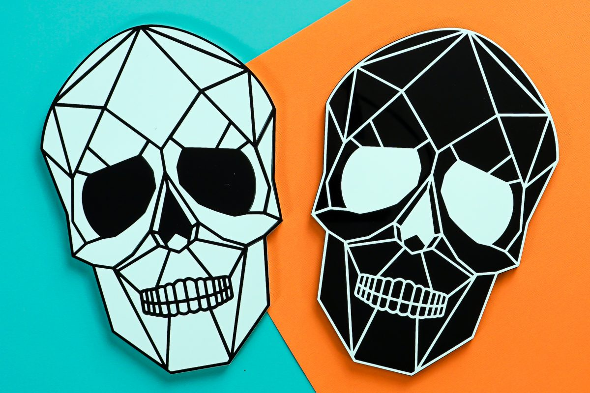 Two skulls on teal and orange background