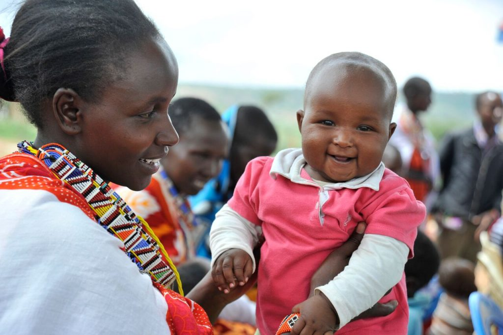 Pampers and Unicef 1 pack = 1 vaccine campaign, working together in the fight against maternal and maternal tetanus. Mum Janet Saitet, 24 with baby Lydia, 8 months at Piliwa Health Facility in Pelewa Town, Kajaido, Kenya where women receive their maternal and newborn tetanus vaccines.