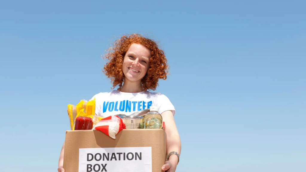 Showing volunteering to donate a box of food
