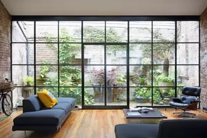 award winning living room designs small layout ideas uk garden design house an industrial style glass and steel wall is all that separates the patio of this notting hill home