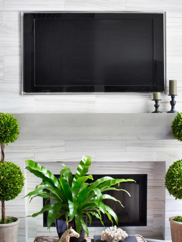how to decorate living room with tv over fireplace simple black and white installing a above the hgtv