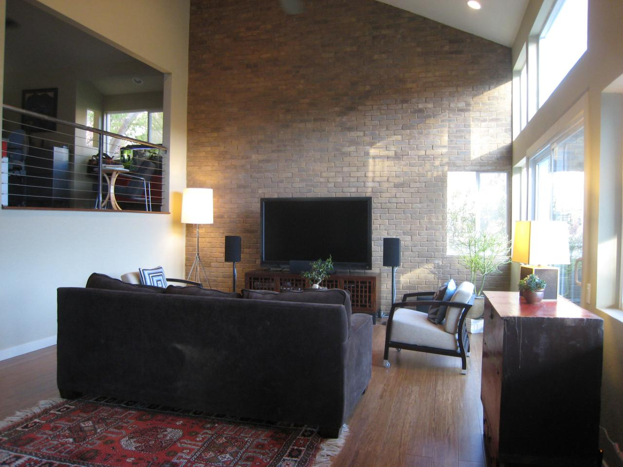 Modern Living Room With Exposed Brick Wall  HGTV