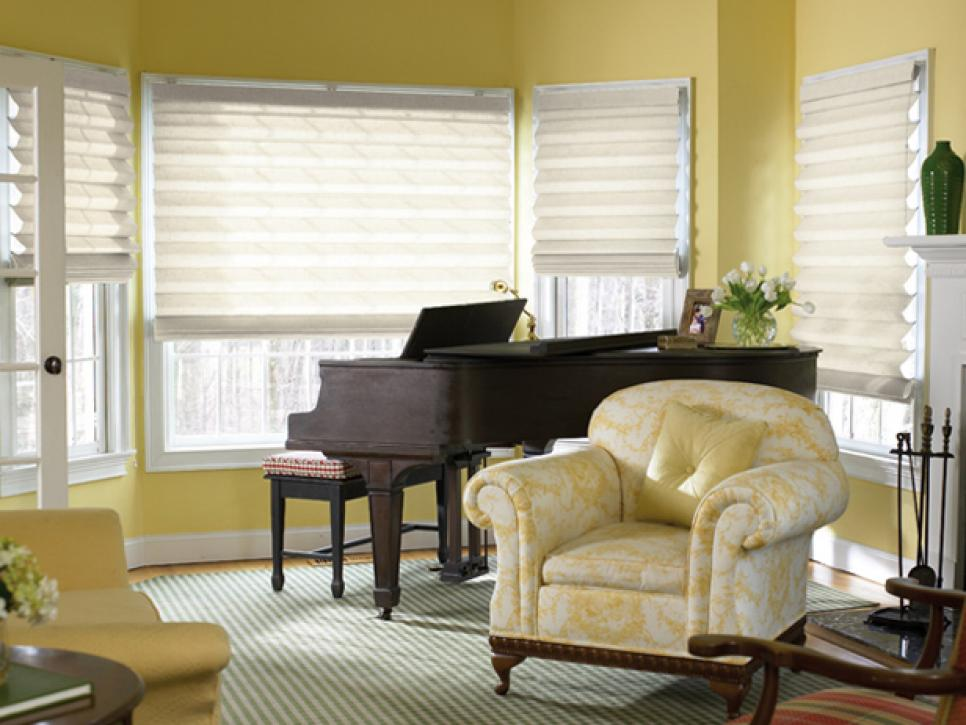 window treatment ideas for living room decorating a with navy blue furniture hgtv control light and privacy cellular shades