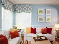 Blue and White Living Room With Orange and Red Accents | HGTV