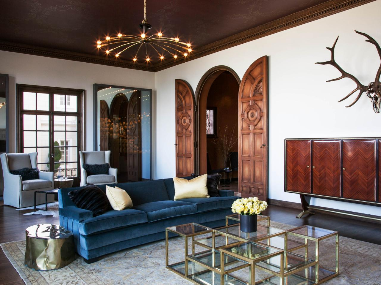 Living Room With a Velvet Sofa and Copper Tin Ceiling  HGTV