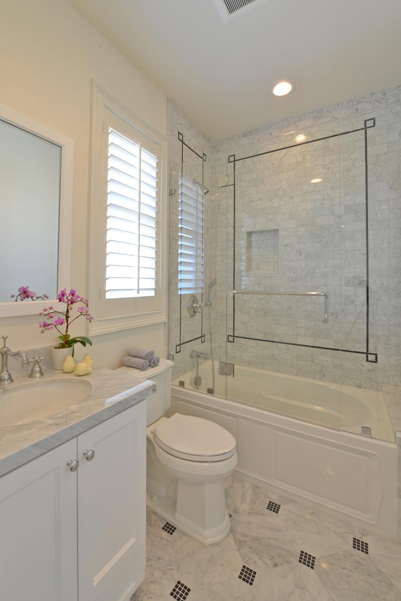 Traditional Neutral Bathroom With Carrara Marble Tile