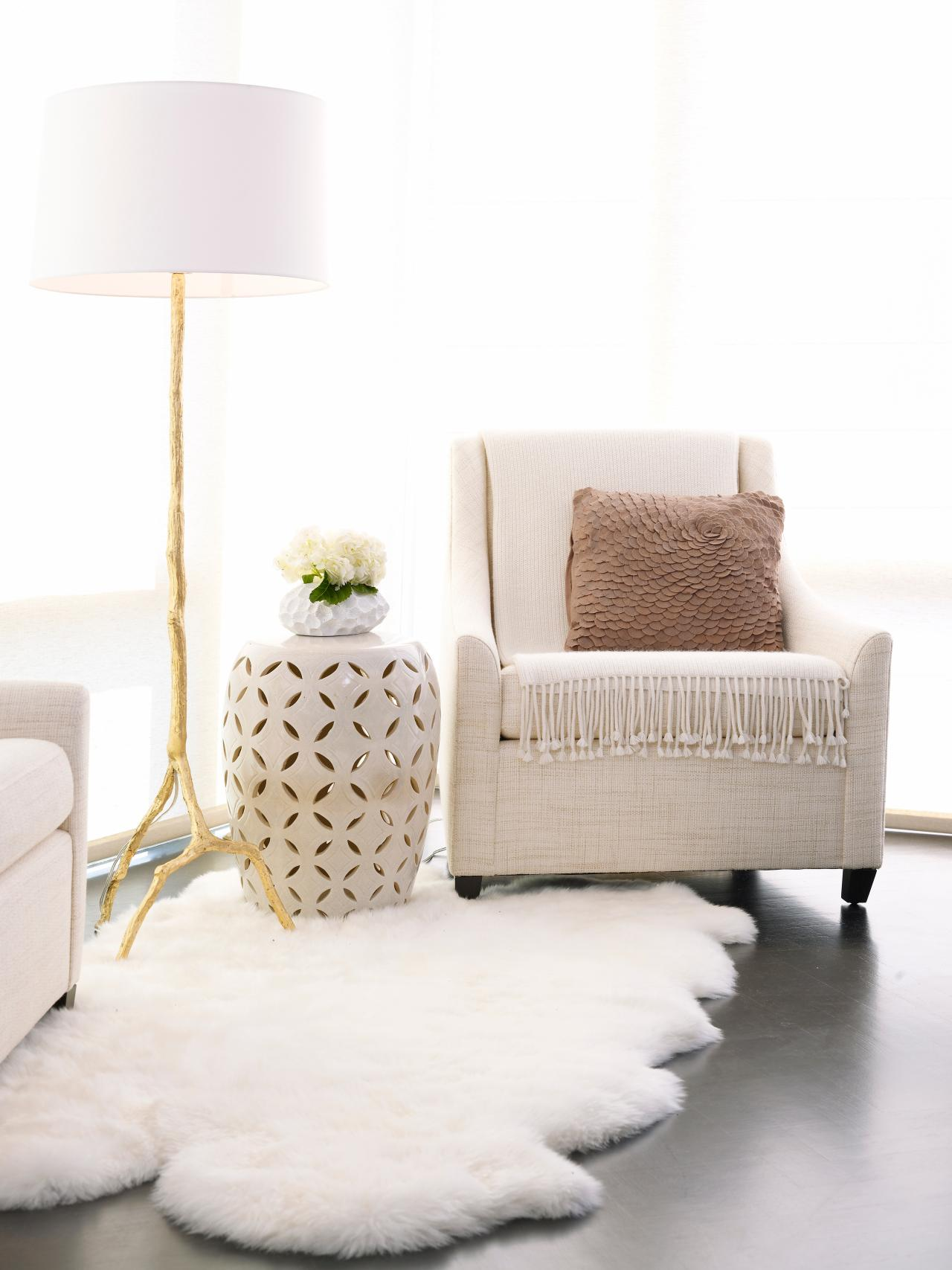 fuzzy sofa build your own sectional recliner neutral upholstered armchair with white faux fur rug hgtv