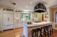White Shaker-Style Cabinets in Peninsula Kitchen | HGTV