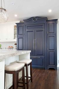 Rich Navy Blue Cabinet in Bright Kitchen With Hardwood ...