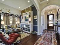 Eclectic Living room With Navy Blue Walls and Foyer | HGTV