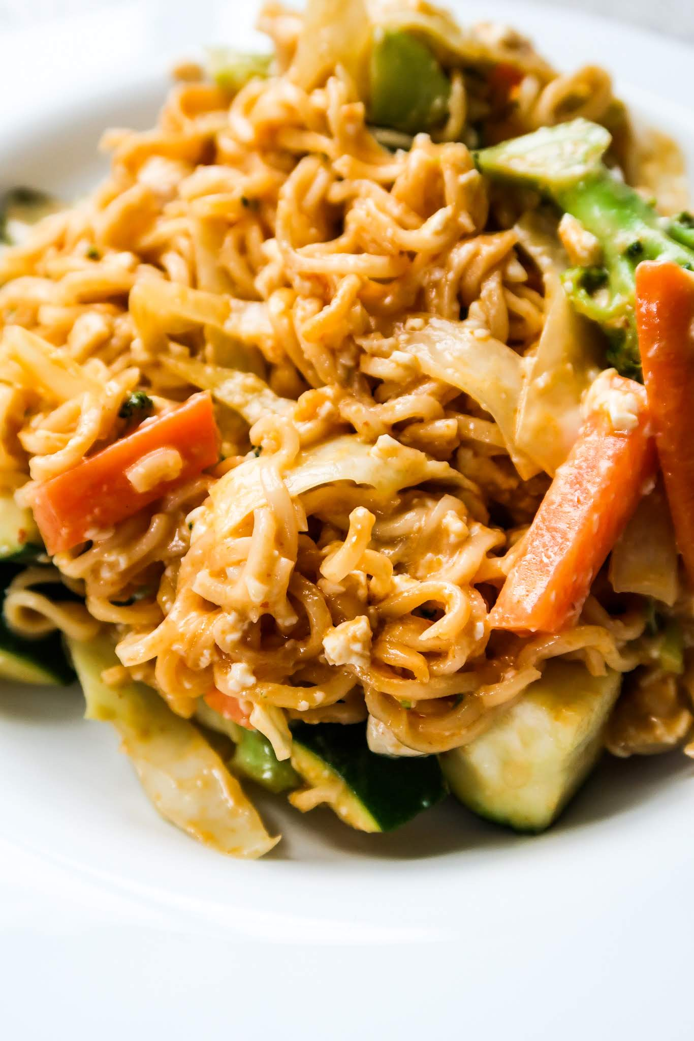 15-minute red curry noodles! An easy healthy dinner recipe that is absolutely divine! Filled with vegetables and tofu this vegan recipe is healthy, quick and warming for dinner! This vegan dinner recipe can also be made gluten free by using gluten-free noodles.
