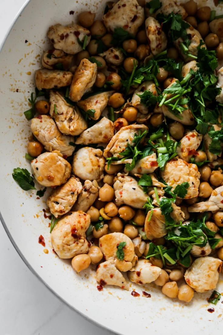 15-Minute Spicy Chicken and Chickpeas! Forget about chicken and rice, forget about chicken and broccoli (if you're doing it to lose weight!) too! This easy healthy chicken recipe is the perfect dinner - it's delicious, it's spicy and you only one pan. Also it's a very versatile and easy meal prep recipe that you can make in about 15 minutes. Pair with some fresh salad on the side and tzatziki or hummus and you've got yourself a tasty and healthy Mediterranean diet dinner in no time. This chicken recipe is gluten-free and high-protein.