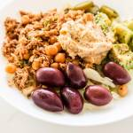 Easy and healthy meal prep lunch bowl recipe. You can easily assemble these tuna chickpea healthy lunch bowls using non-perishable foods and some fresh vegetables. They're delicious and quick!