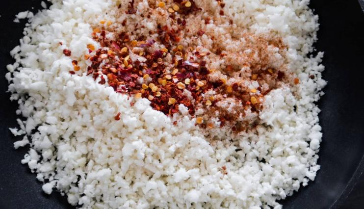 Step 2: Saute your cauliflower rice and add spices.