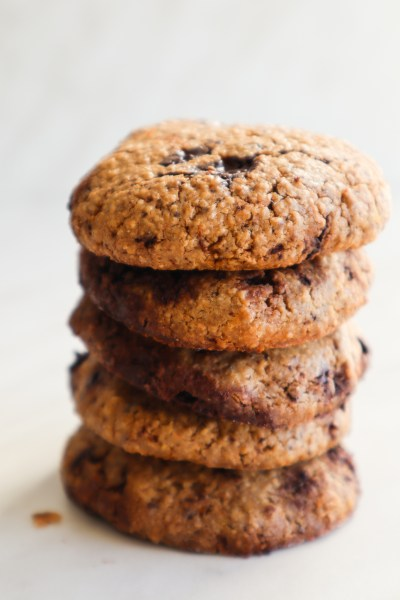 Learn how to make oatmeal cookies from scratch with this easy and healthy flourless oatmeal cookie recipe! To make these healthy cookies we'll use gluten free oats, coconut sugar, an egg, coconut oil, some baking soda and some chocolate chips! Soft and chewy, kids love these - as a treat, or a healthy snack! These are seriously the best homemade oatmeal chocolate chip cookies!
