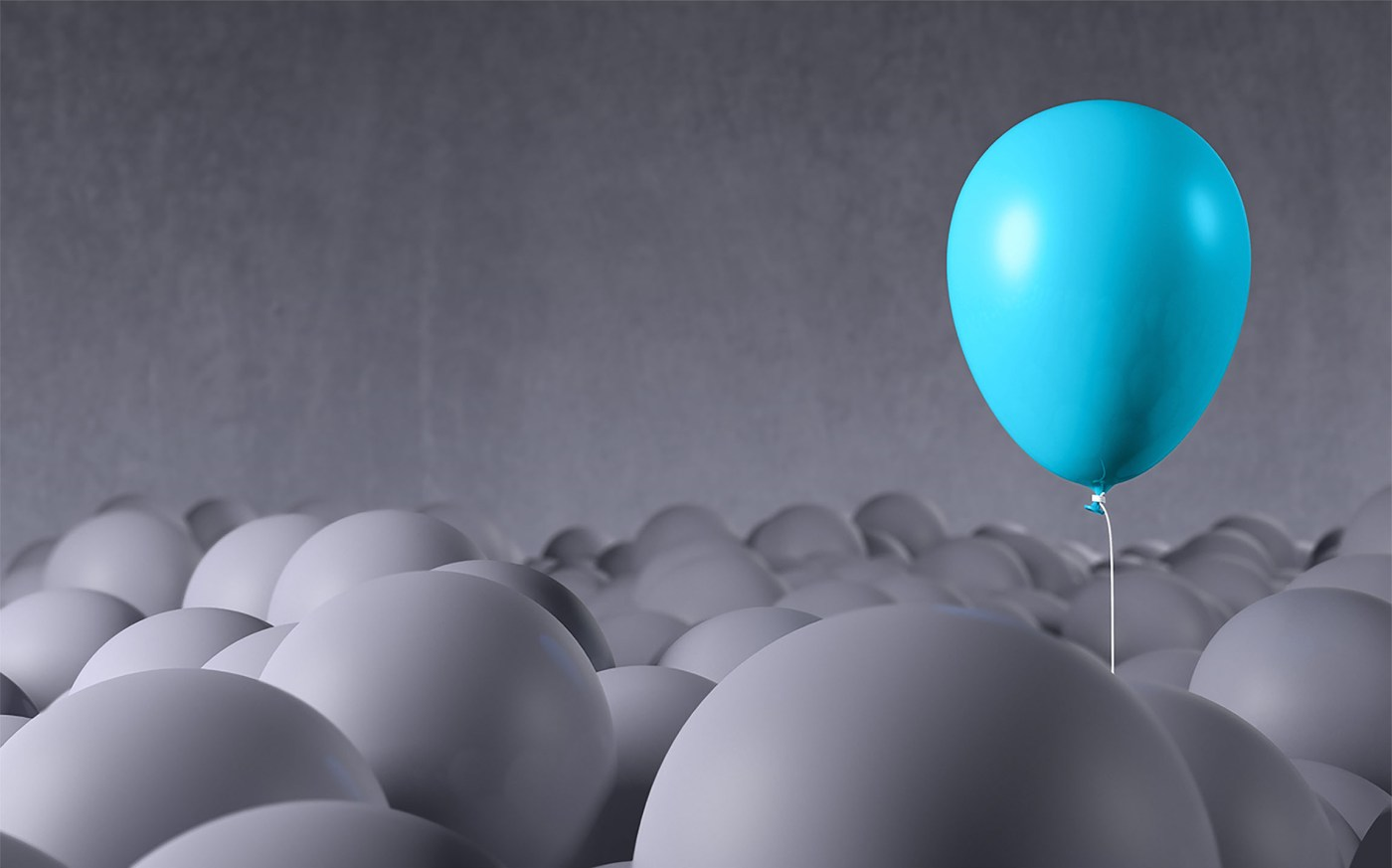 Blue balloon rising from gray background: individuality, standing out