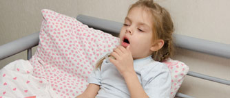 girl-lying-in-bed-coughing_sizexs
