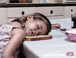 child-asleep-on-bread