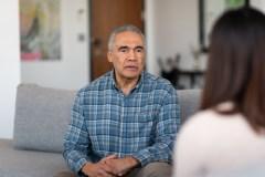 Older man talking to psychotherapist