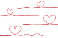Four hearts formed of red yarn isolated on a white background