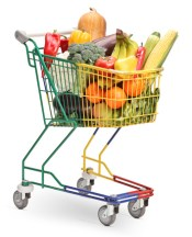 Colorful pushcart filled with many fruits and veggies