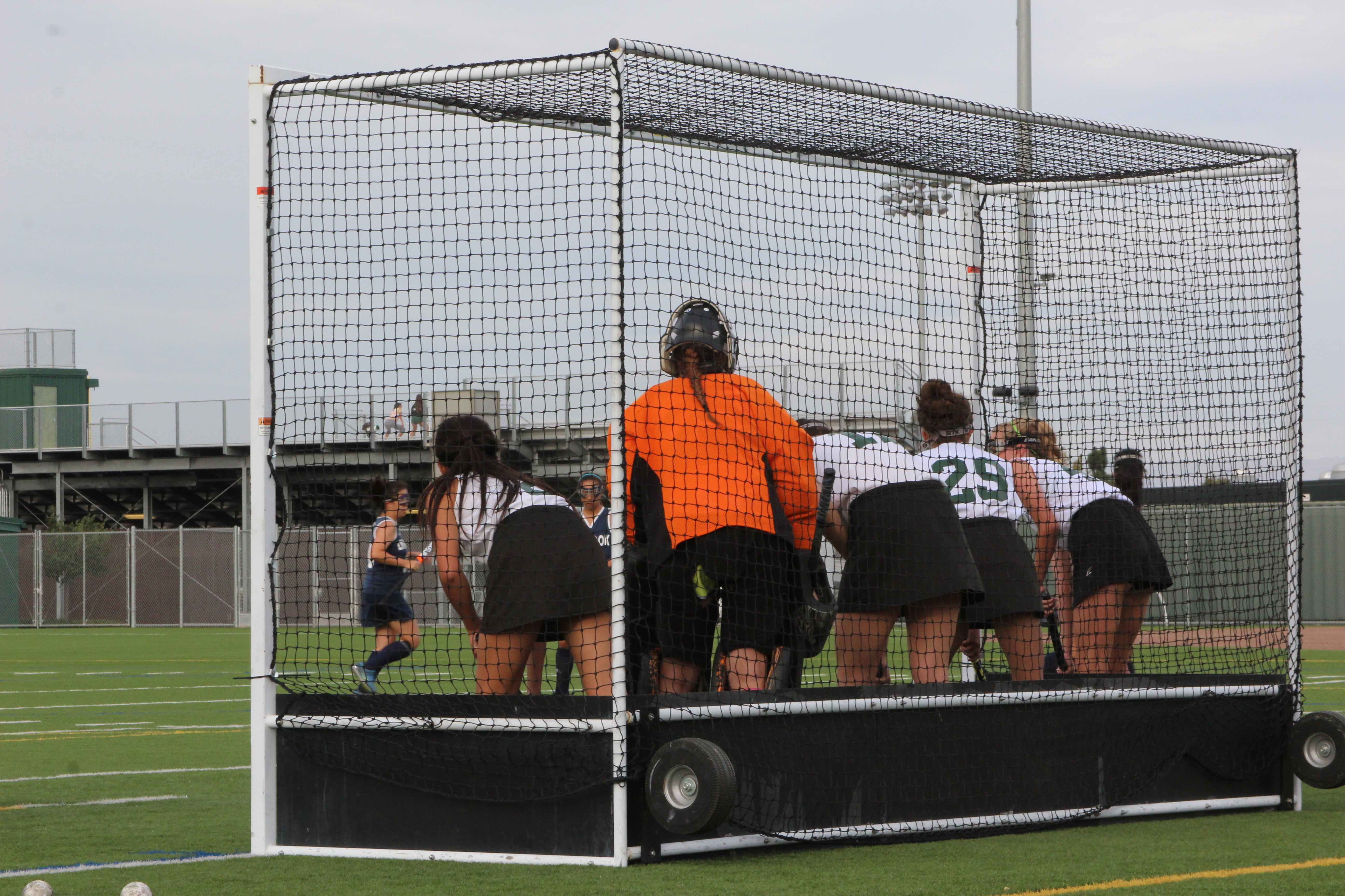 Members of the junior varsity field hockey team guard the goal in a game against Lynbrook
