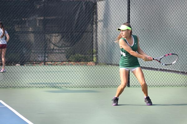 Freshman Zoe Clydesdale-Eberle makes a backhanded shot in the first round of CCS on Nov. 23.