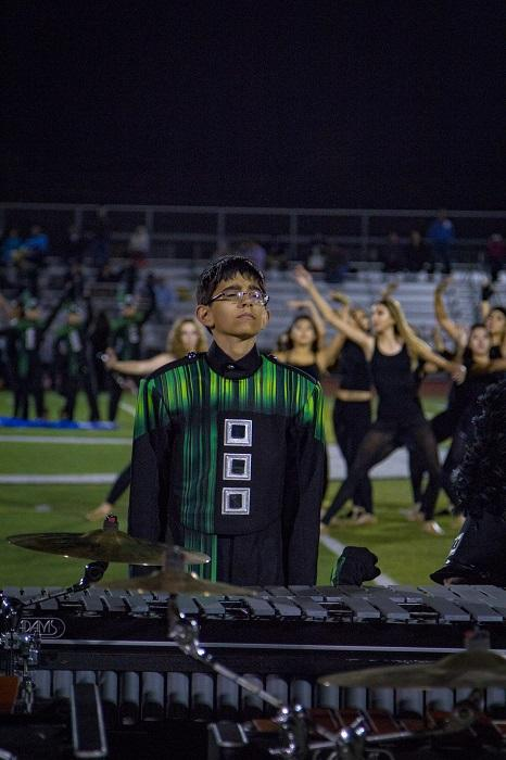 Sophomore+percussionist+Taraz+Chandler+performs+with+the+marching+band+during+the+halftime+show.%0A