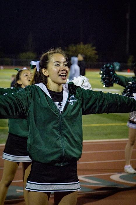 Senior+cheer+captain+Madie+Tsao+leads+the+cheerleaders+in+support+of+the+Mustangs+in+the+fourth+quarter.%0A