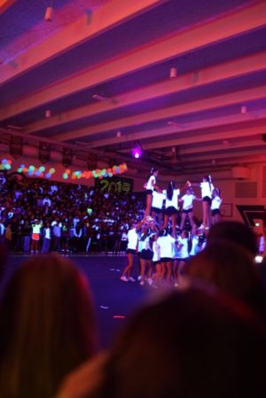 Cheer performing their moving stunt sequence.