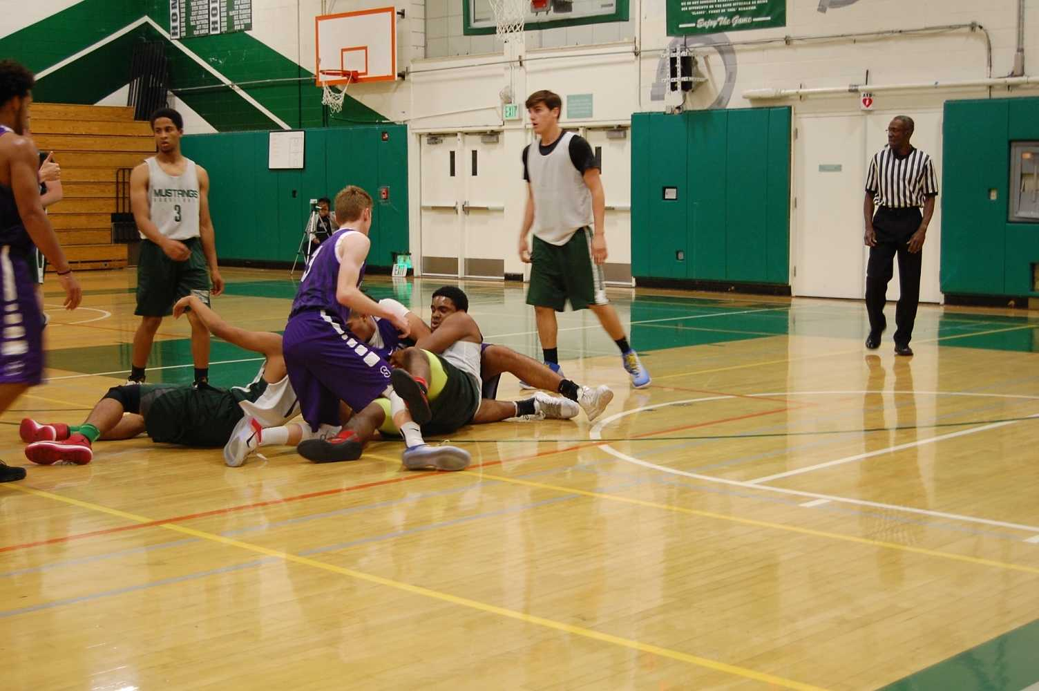 Senior Dante Johnson and junior Eric Sathy fight for the ball during a preseason game against Sequoia